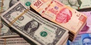 Baja el dólar y cierra en 15.40 pesos