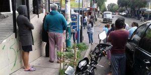 Encuentran a joven ahorcado en un teléfono público en Tlalpan